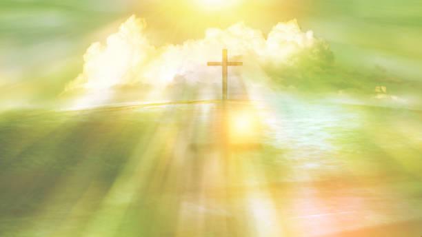 symbol der religiösen kreuz an einem strand mit sonnenlicht strahl und cloud - taufe fotos stock-fotos und bilder