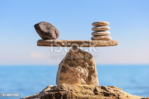 Symbol of scales is made of stones on the boulder