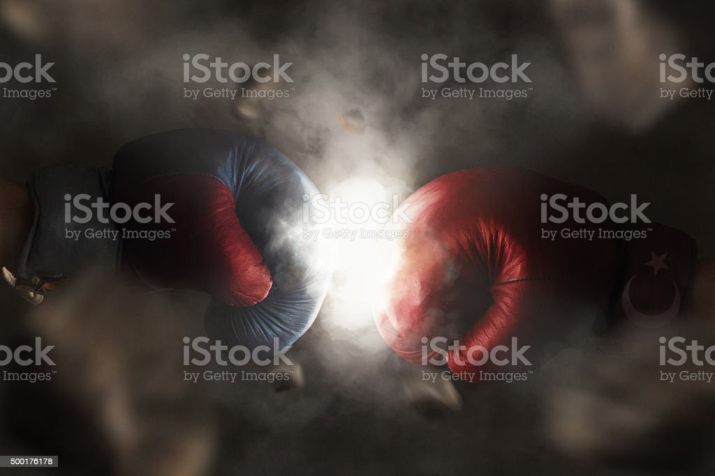 Symbol of the Crisis between Turkey and Russia Symbol of the Crisis between Turkey and Russia symbolized with Boxing Gloves 2015 Stock Photo