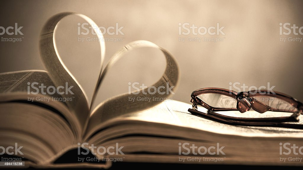 symbol of the heart of the pages of an old book stock photo