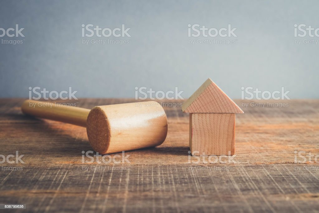 Symbol of worldwide real estate crisis. wood hammer and house with filter effect retro vintage style stock photo