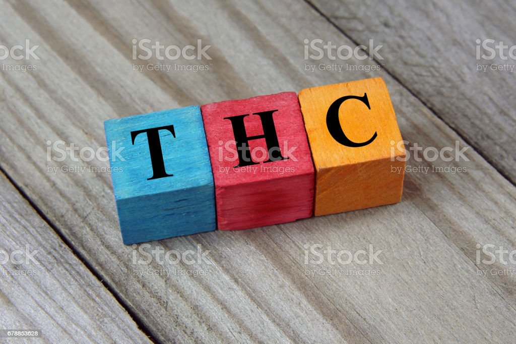 THC symbol on colorful wooden cubes stock photo