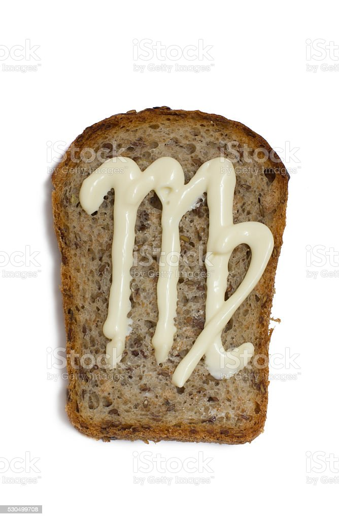 symbol the virgo on a piece of bread stock photo