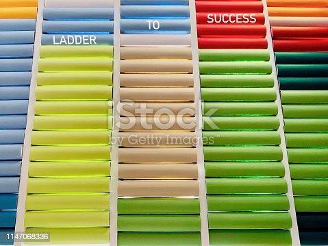 istock Symbolic book ladder to success 1147068336