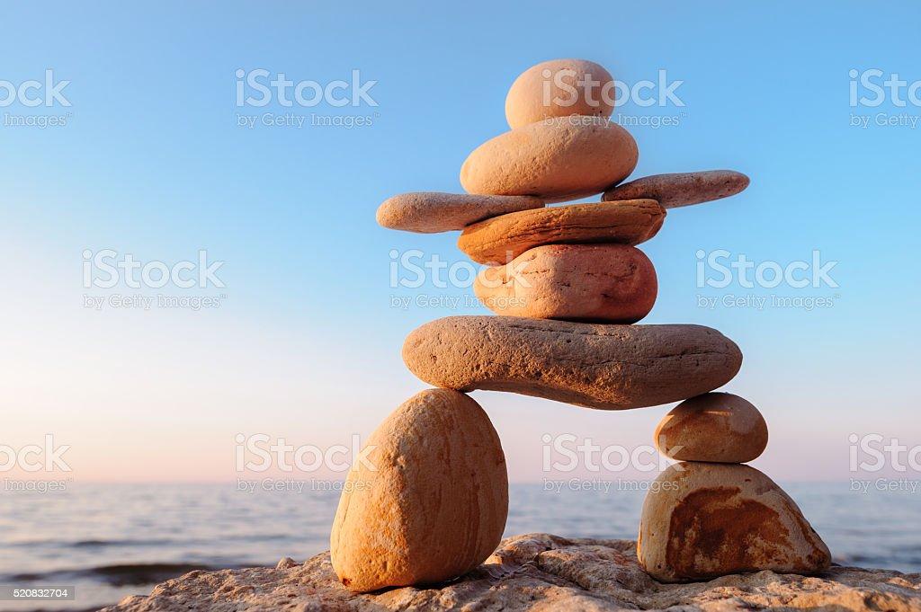 Symbolic figurine of stones stock photo