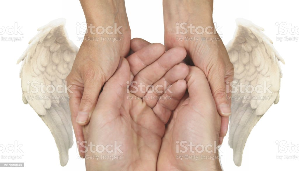 Symbolic Helping Hands with Angel Wings stock photo