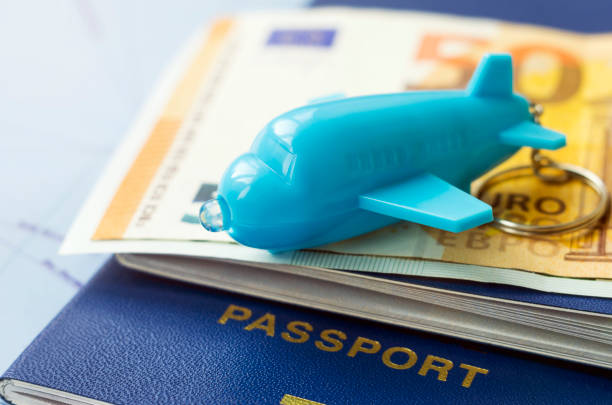 Symbolic image of buying a airline tickets for travel a small blue picture id924844186?b=1&k=6&m=924844186&s=612x612&w=0&h=nwocyoi6cnlezolndwa3vthlrntnfnlxlxrsozupnqu=