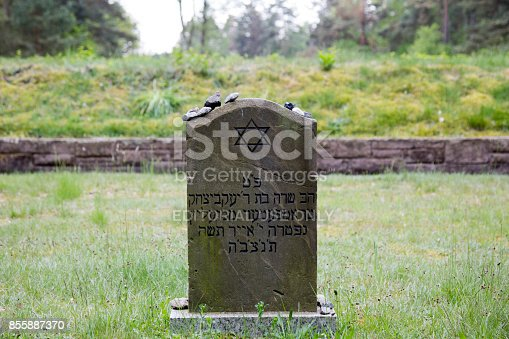Bergen-Belsen, Germany, May 20 - 2017:  Symbolic Jewish gravestone on the grounds of former concentration camp Bergen-Belsen in Germany where 70.000 died during World War II.