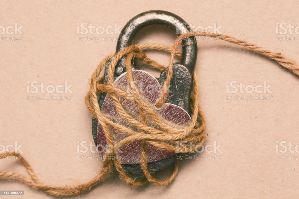 Symbolic photo to the day of St. Valentine. Love, romance and affection. Love symbol. Lock and heart. stock photo
