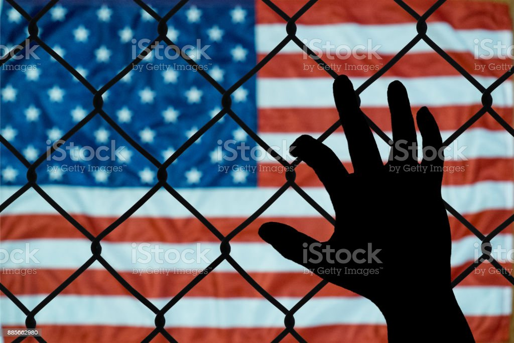 A symbolic representation of immigrants and the united states of america This is an emotional picture about the immigration policies of the united states Abstract Stock Photo