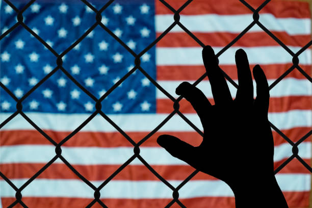 A symbolic representation of immigrants and the united states of america stock photo