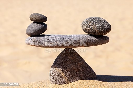 Symbolic scale of the stones. Concept of harmony and balance. work-life, emotional balance