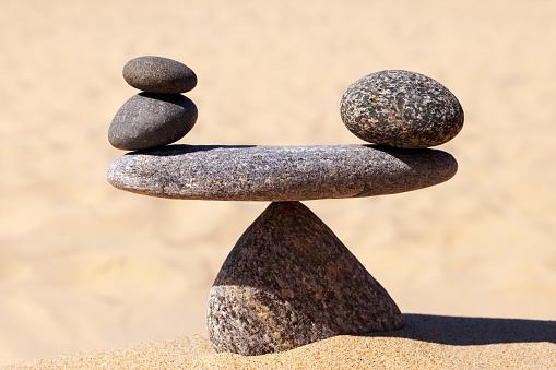 Symbolic scale of the stones. Concept of harmony and balance. work-life, emotional balance