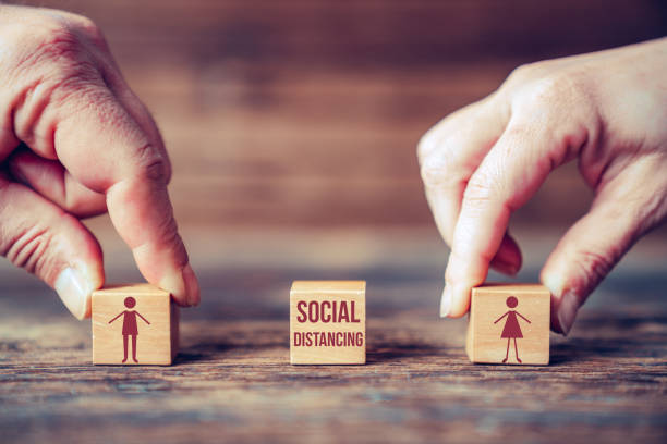 symbolic two person stay away each other keeping social distance, to protecting from the global treath. - social distancing stock pictures, royalty-free photos & images