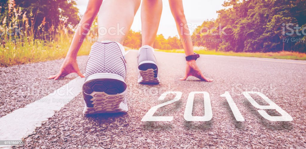 2019 symbolises the start into the new year.Start of people  running on street,with sunset light.Goal of Success stock photo