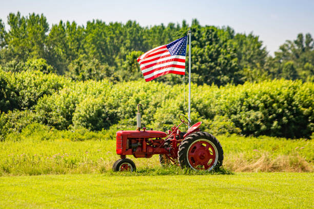 Symbols of American farming: tractor and flag stock photo
