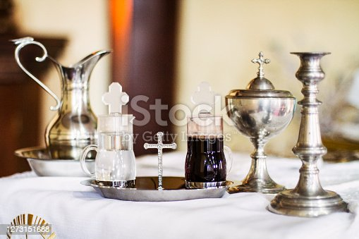Liturgical objects used by priests during the celebration of the Mass in the Catholic Church. Holy water and chalice mass that contain wine and hosts, blood and body of Christ.