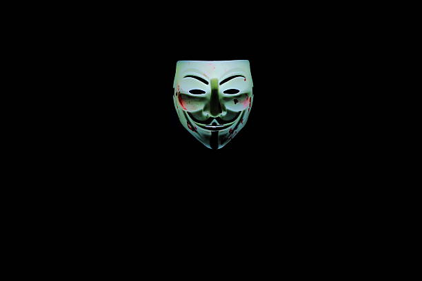 symbols - guy fawkes mask stock photos and pictures