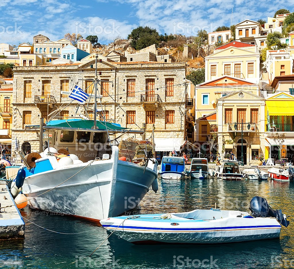 Symi island - Colorful houses and small boats stock photo