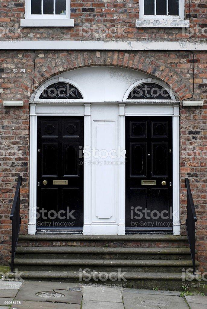 Symmetric british doors royalty-free stock photo