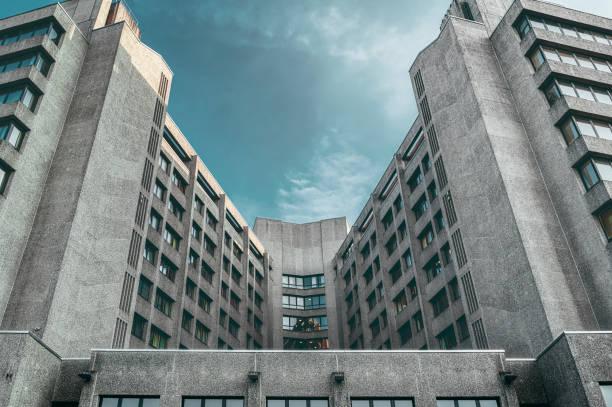 symmetric concrete skyscraper, toned image stock photo