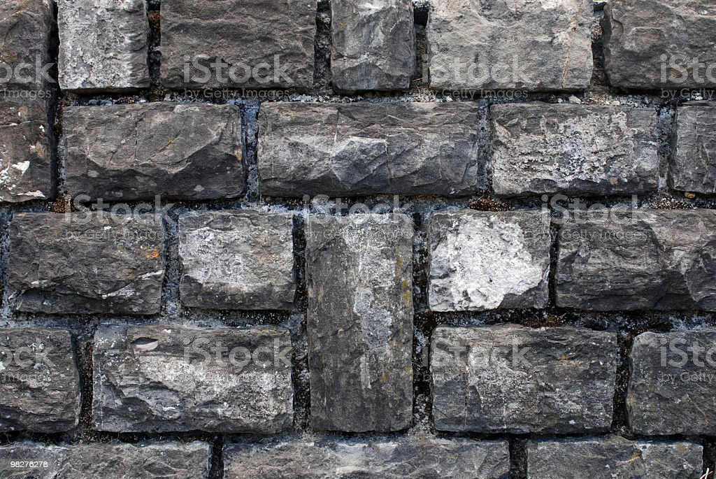 symmetric grey stone wall background royalty-free stock photo