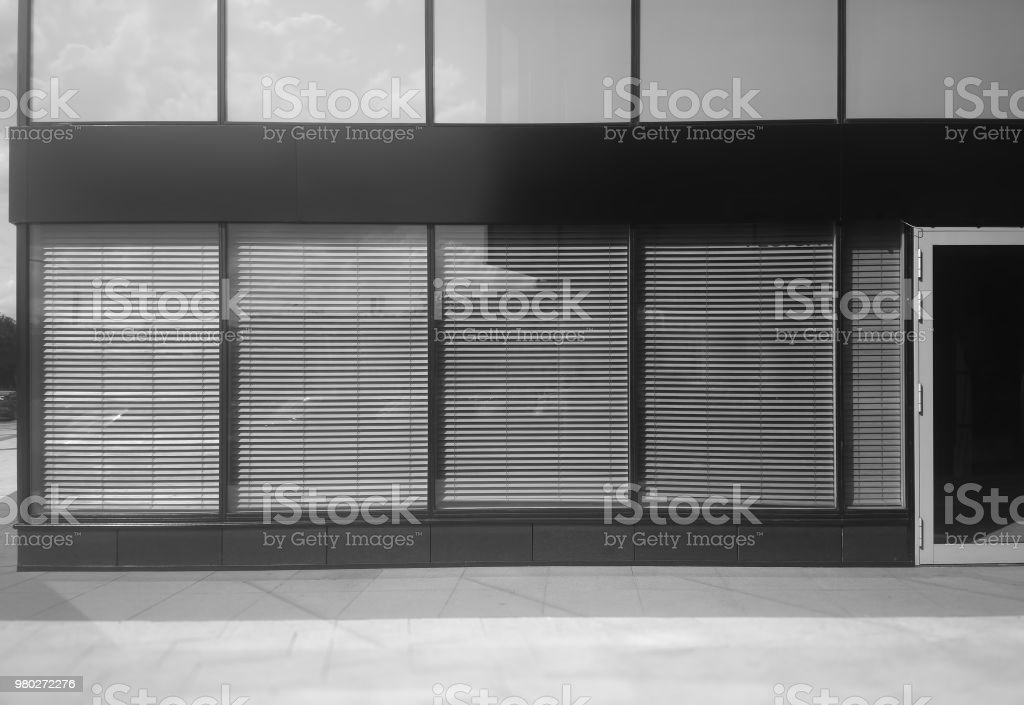 Symmetric store front with closed door city background stock photo