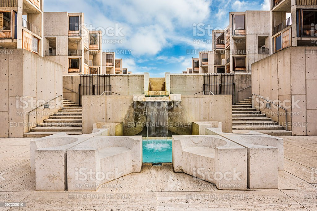 Symmetrical architecture of the Salk Institute with blue fountain pool stock photo