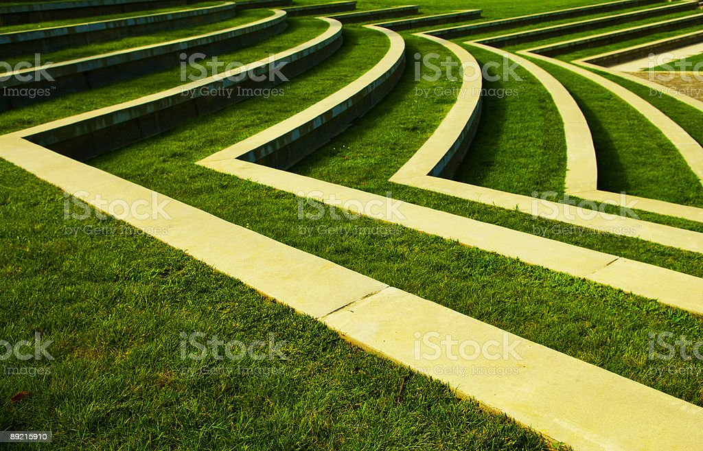 Symmetrical Green Grass Lawn with Rows of Steps at a Park stock photo
