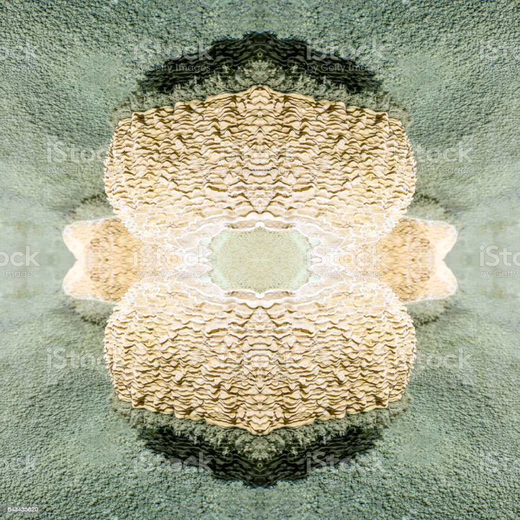 Symmetrical kaleidoscope surreal and abstract shapes of gours calcite formation rimestone in french caves stock photo