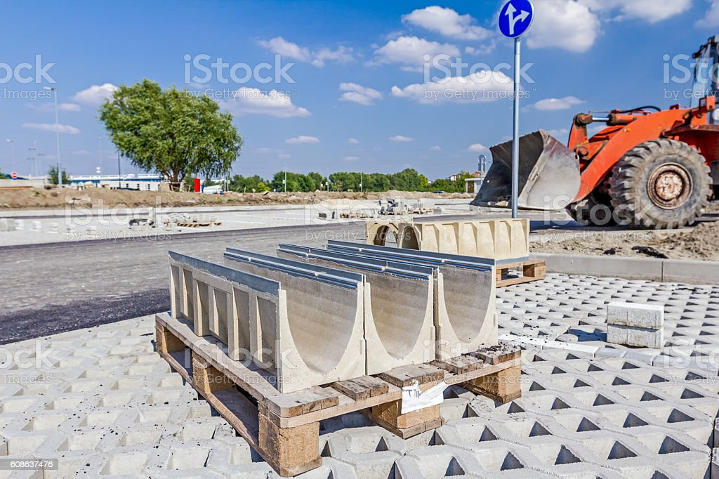 Symmetrical oblong precast rainwater canal placed on pallet is r stock photo