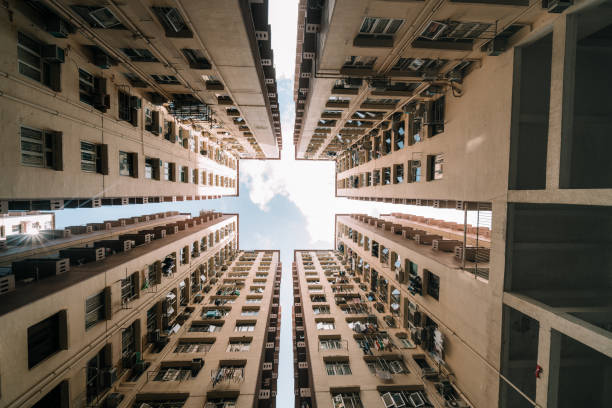 symmetrical residential buildings in hong kong, china - council flat stock photos and pictures