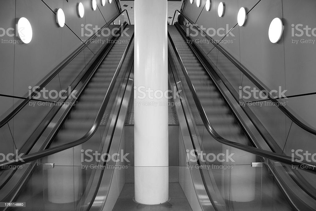 Symmetry: Escalators in Black and White royalty-free stock photo