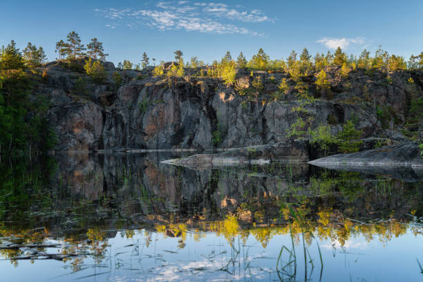 Symmetry reflection of Ladoga Lake cliffs. Karelia Symmetry reflection of Ladoga Lake cliffs. Karelia, Russia republic of karelia russia stock pictures, royalty-free photos & images