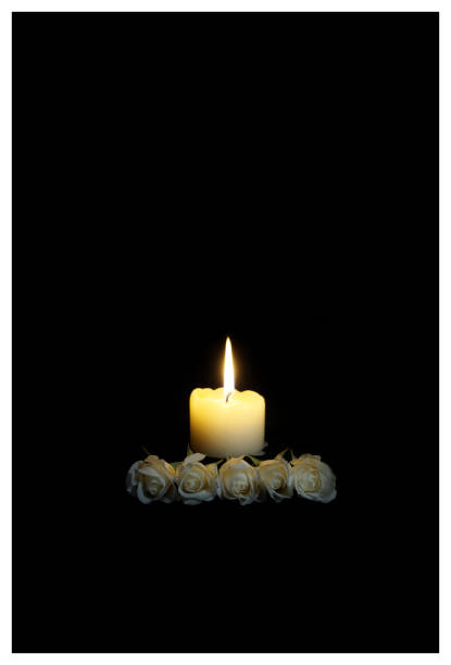 Sympathy card. Frame with white roses and burning candles in darkness. candles burning in the black background. Empty place for text. Appreciation, feelings compliment, mourning frame. Condolences card, Prayers and Deepest Sympathy concept Funeral symbol. stock photo