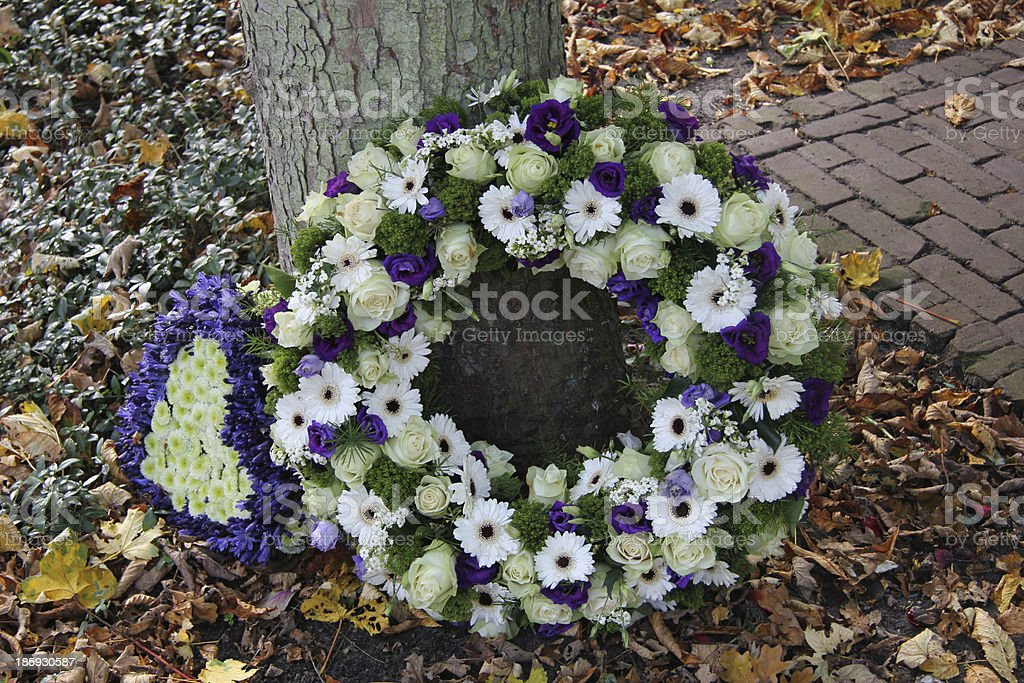Sympathy wreath in white and purple stock photo