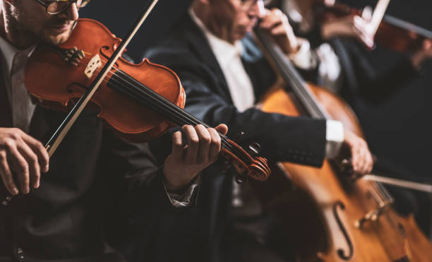 Symphonic string orchestra performing on stage stock photo