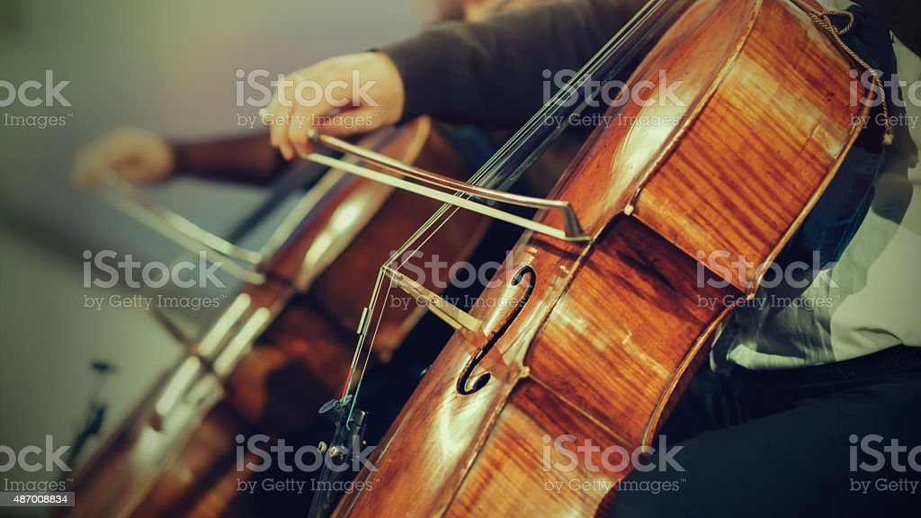 Symphony orchestra on stage, hands playing cello royalty-free stock photo