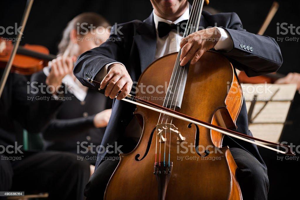 Symphony orchestra performance: celloist close-up stock photo