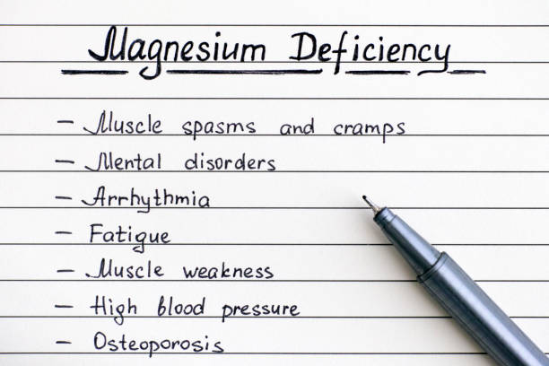 symptoms of magnesium deficiency writing on the list with pen. - deficient stock pictures, royalty-free photos & images