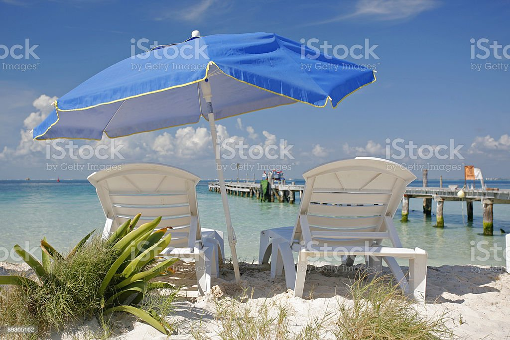 Syn Loungers and Umbrella royalty-free stock photo