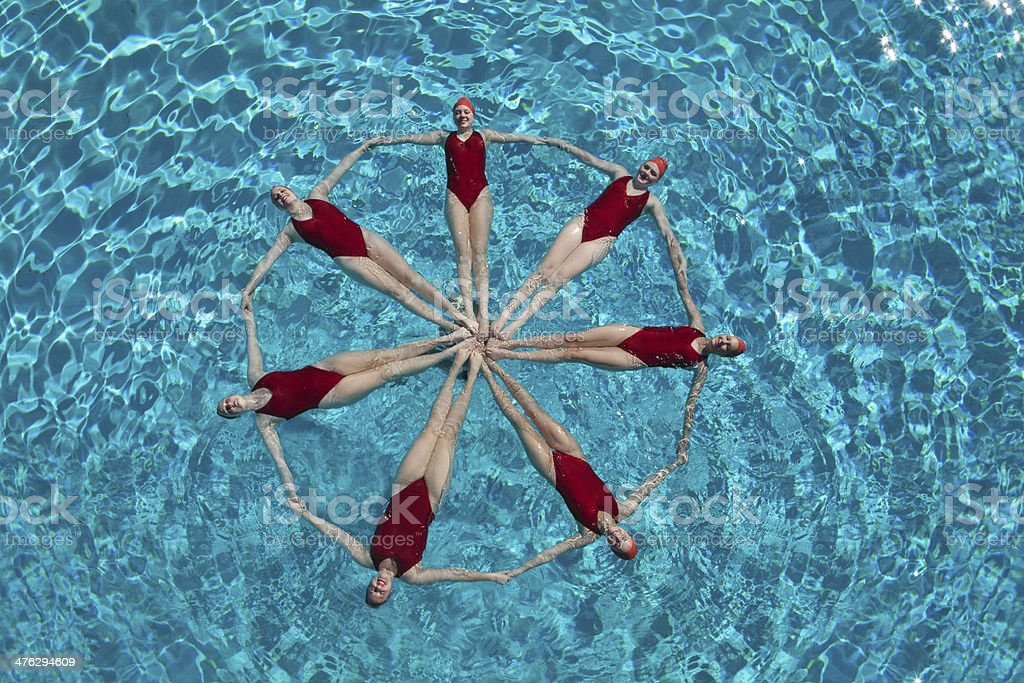 Synchronised Swimmers Forming A Circle stock photo