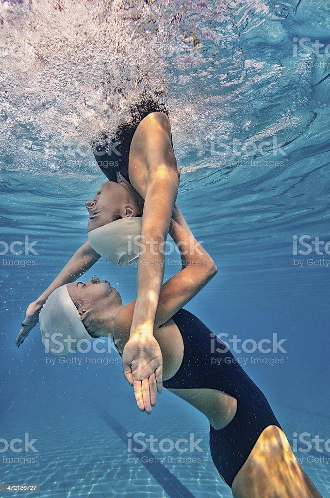 Synchronized swimming - hidden effort royalty-free stock photo