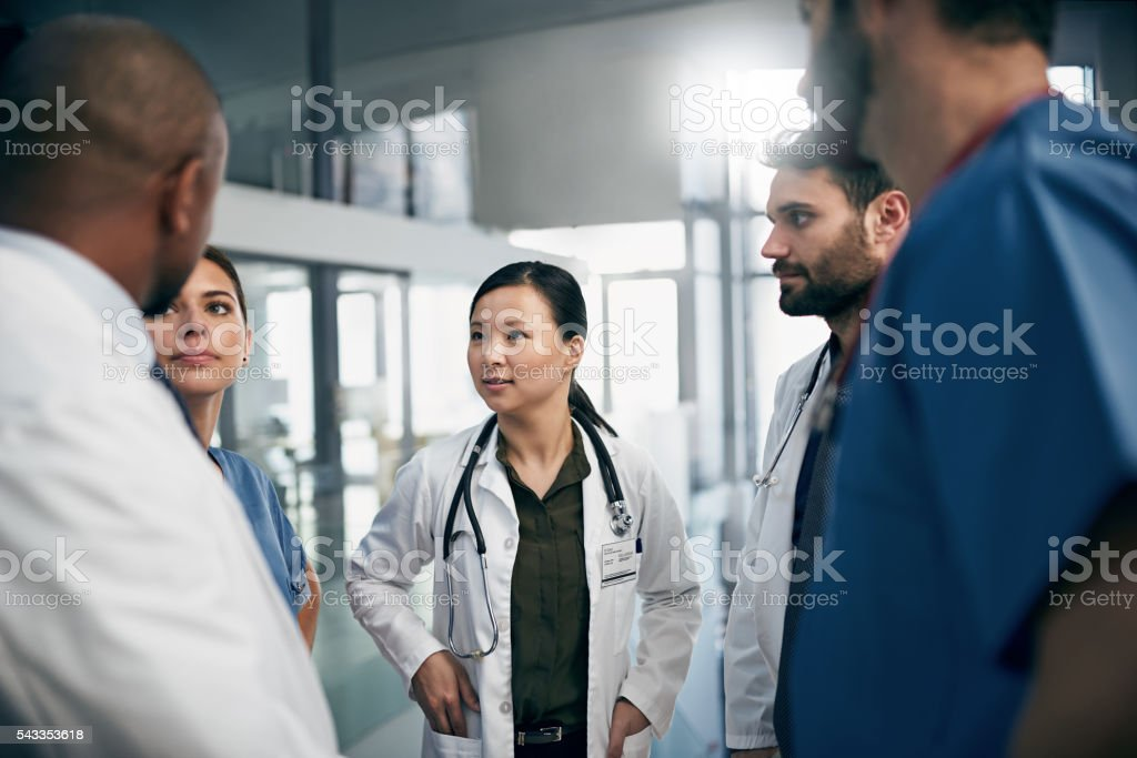 Synchronizing their tasks before shift stock photo