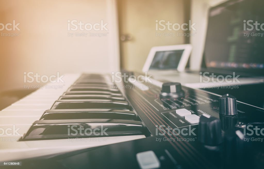 Synthesizer keyboard for computer music production stock photo