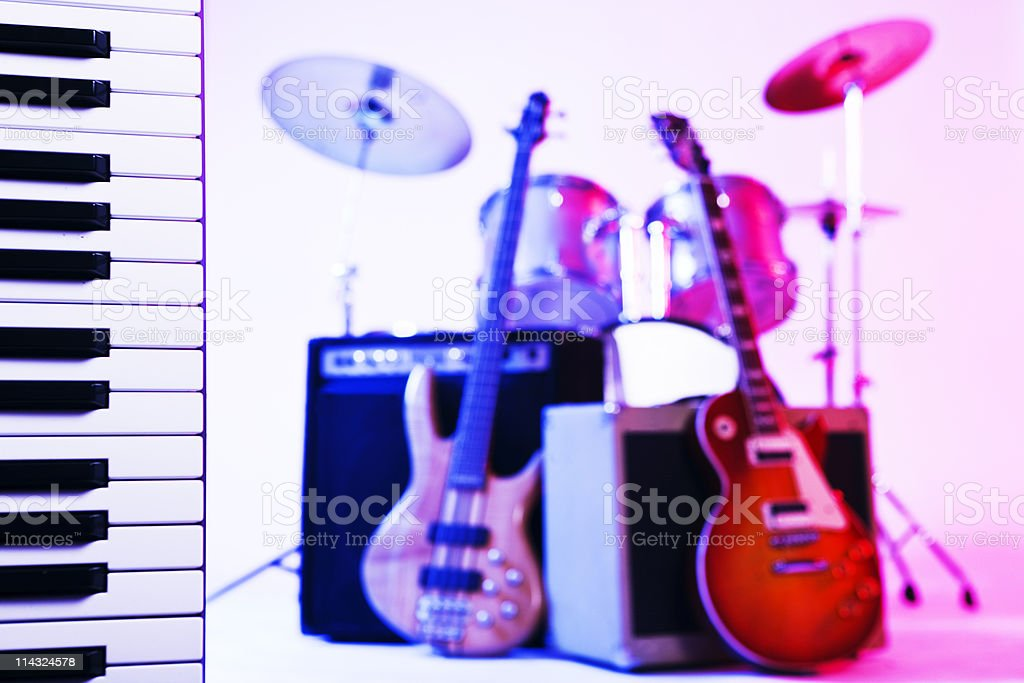 Synthesizer keyboard with guitars and drums royalty-free stock photo