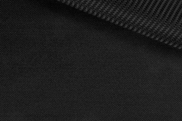 synthetic fabric texture. background of black textile - nylon texture stock pictures, royalty-free photos & images
