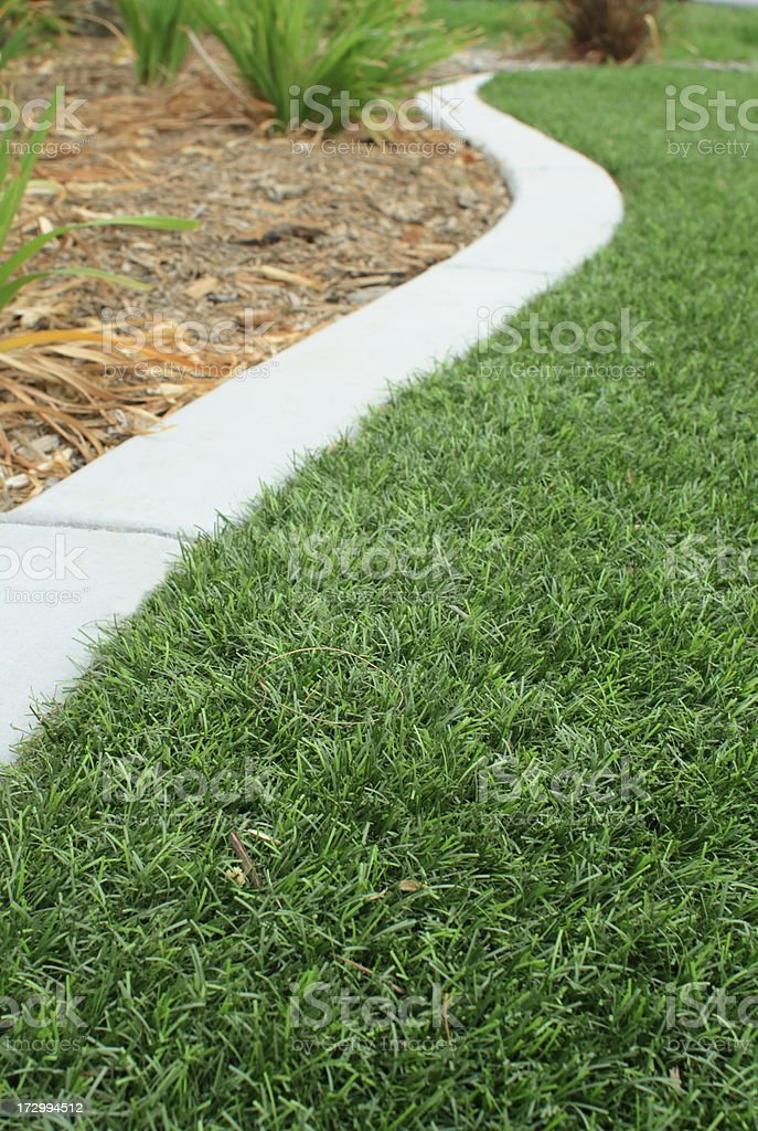 Synthetic Grass and Mow Curb stock photo