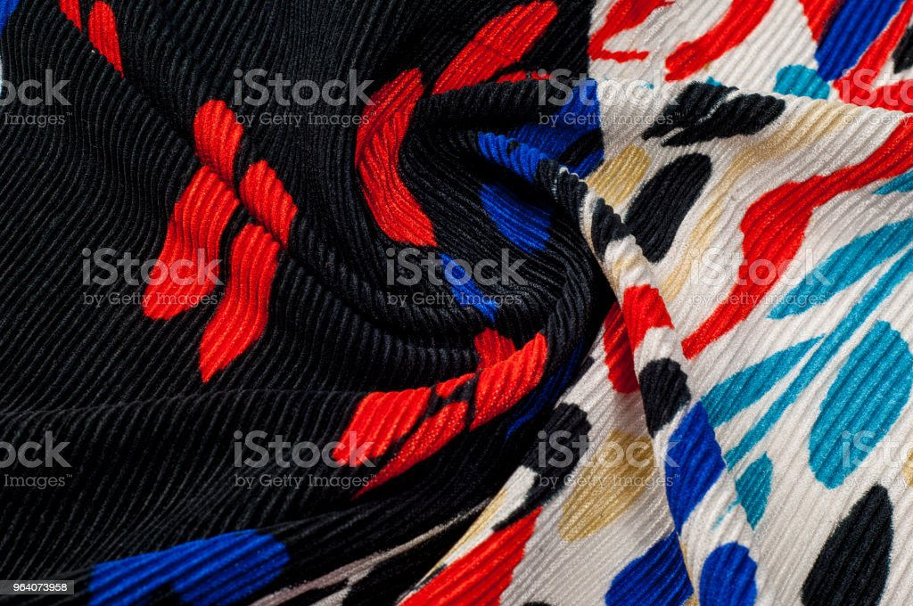 Synthetic knitted fabric, white and black background. The flowers are red and blue. A red and blue pattern on a black background, incredible weight and quality, - Royalty-free Abstract Stock Photo