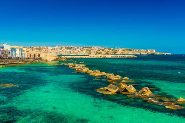 Syracuse, Sicily. Beautiful view of the Ionian Sea coastline in Ortigia, Italy stock photo
